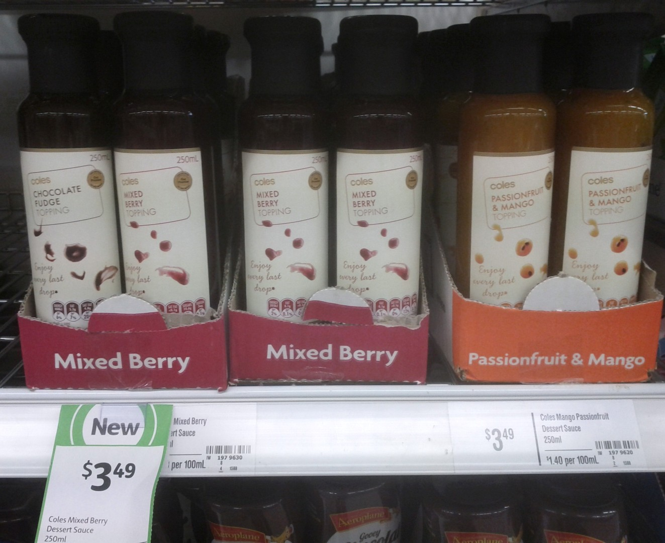 Coles 250mL Topping Chocolate Fudge, Mixed Berry, Passionfruit & Mango
